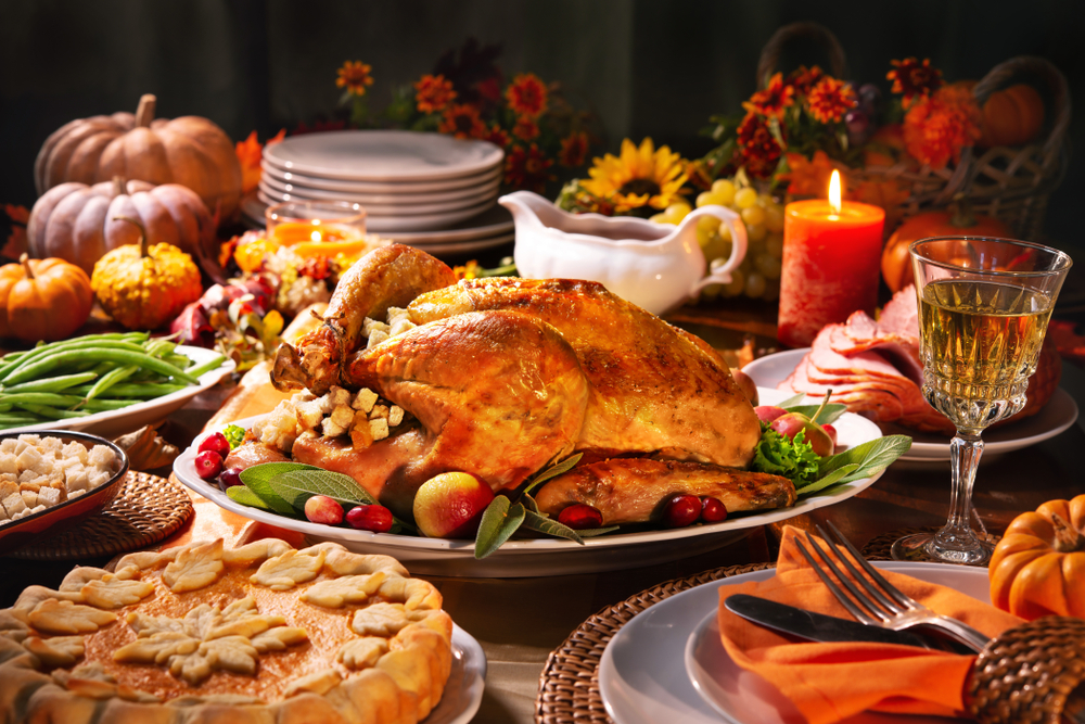 Thanksgiving,Dinner.,Roasted,Turkey,Garnished,With,Cranberries,On,A,Rustic